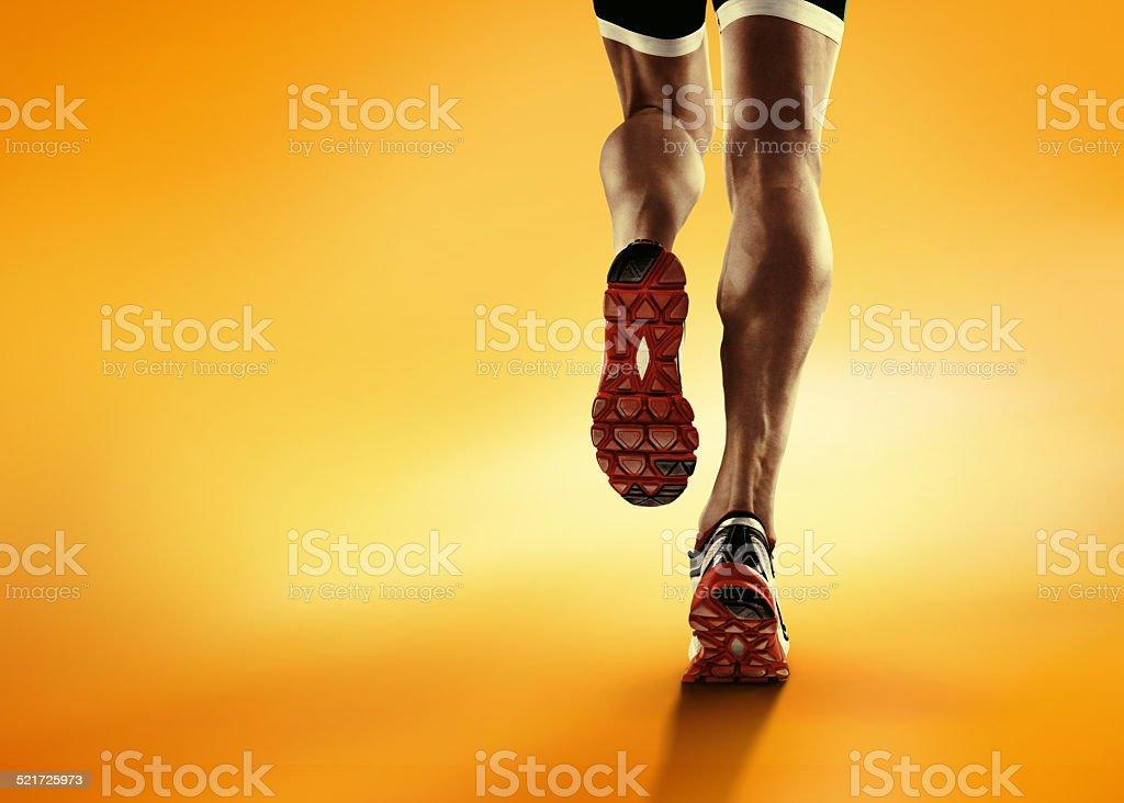 Sports background. Runner feet running closeup on shoe. stock photo