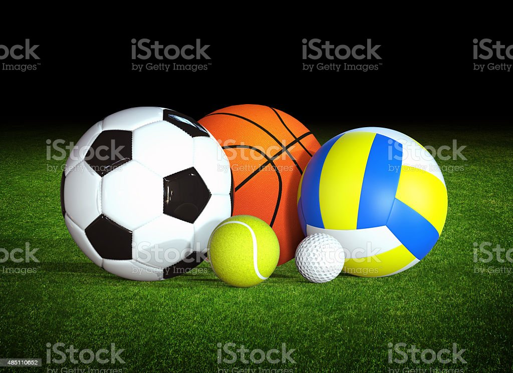 Sports balls in stadium stock photo