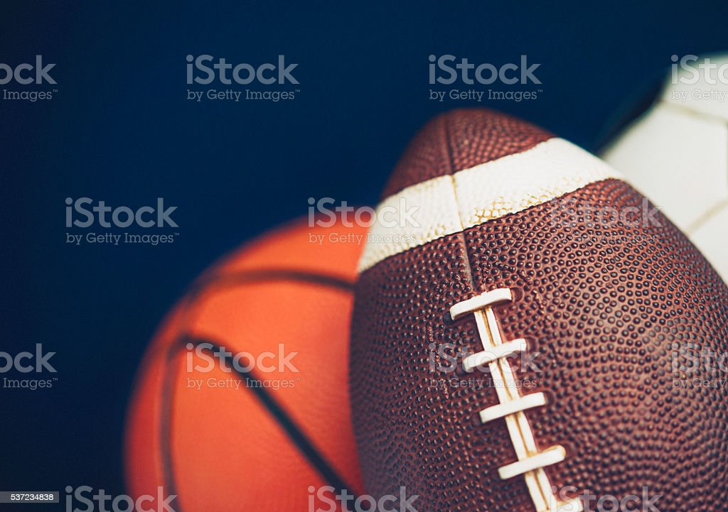 Sports balls including basketball, soccer ball and American football