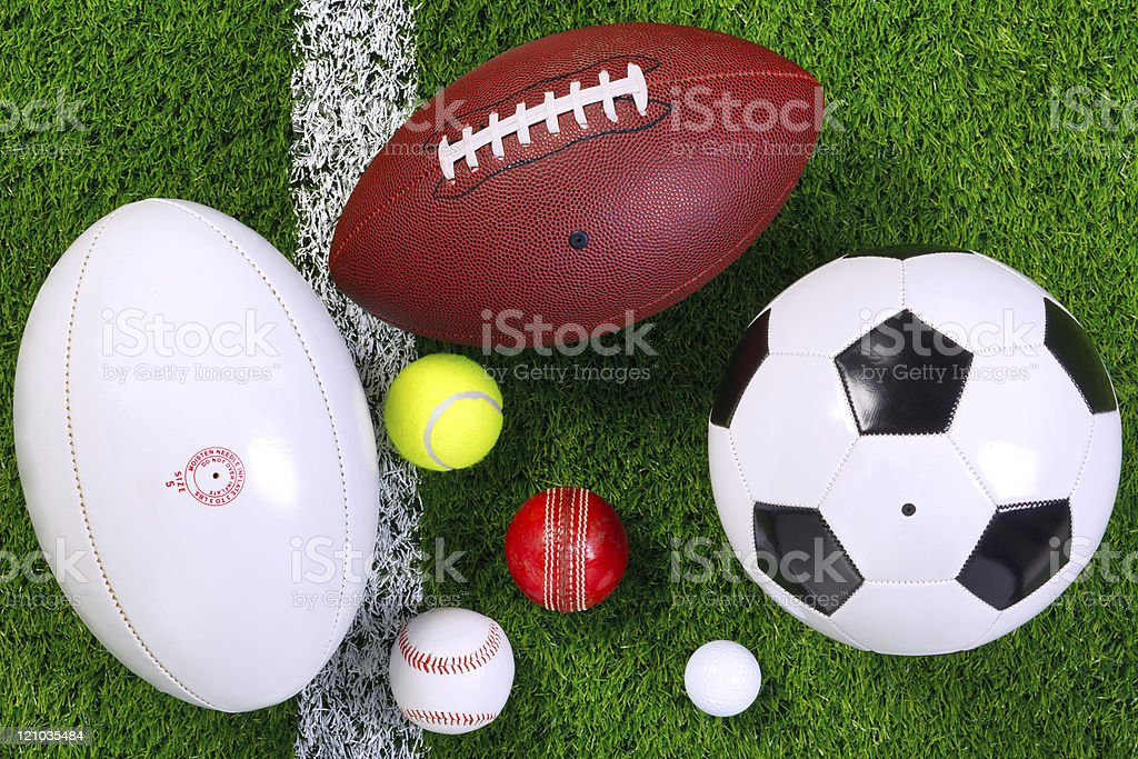 Sports balls on grass from above. stock photo