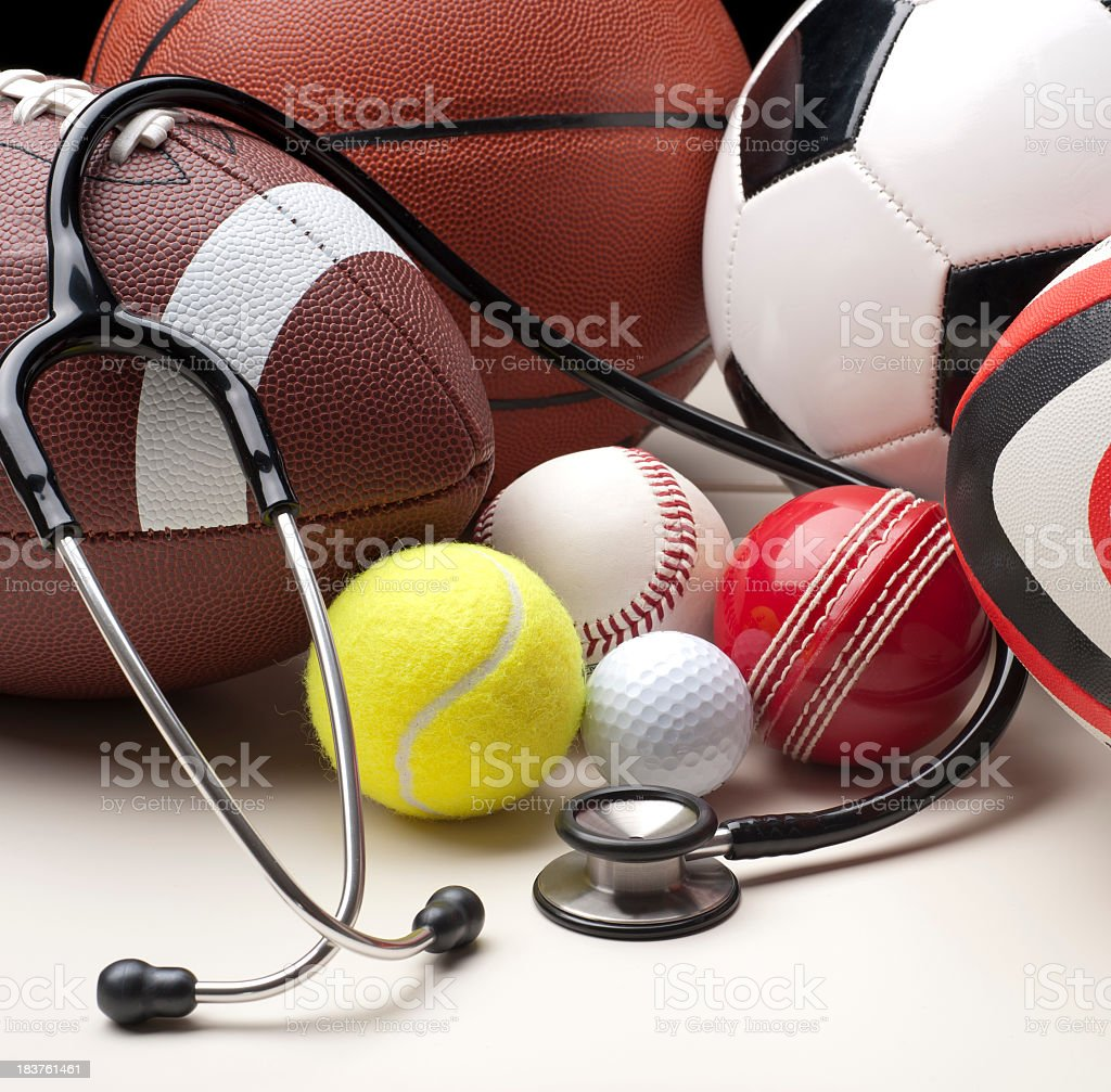 Sports balls with stethescope stock photo