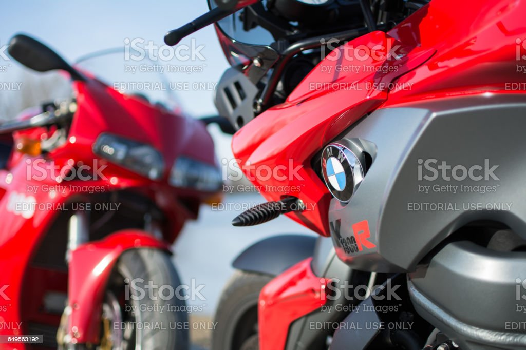 Sports BMW and Ducati Motorcycles photographed outdoors stock photo