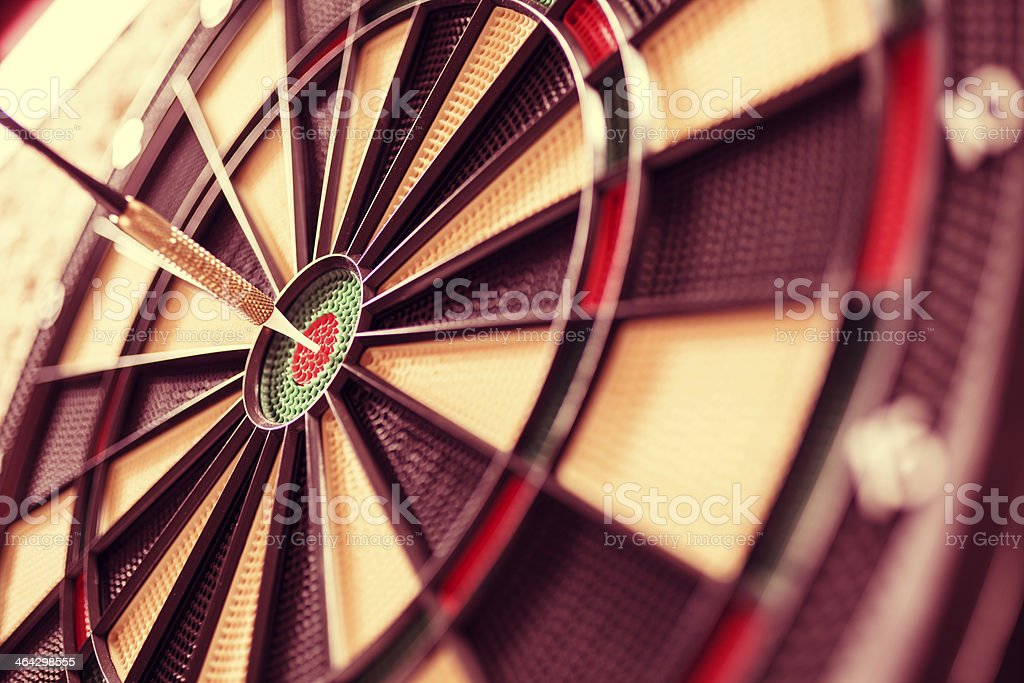 Sports: Bull's Eye!  Dart directly in center of dartboard. Accuracy. stock photo