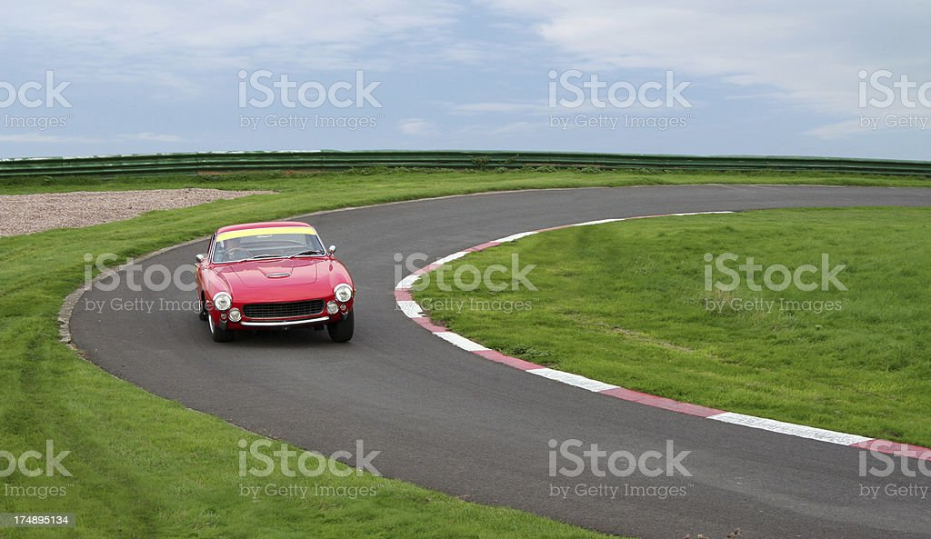 Sports car cornering stock photo