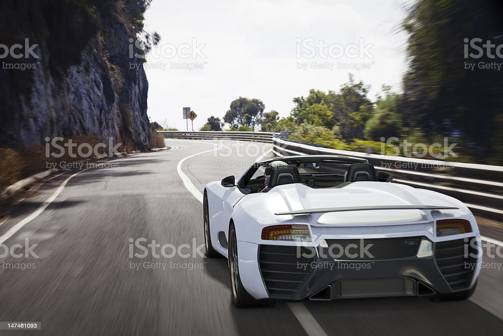 Sports Car on a Coastal Road stock photo