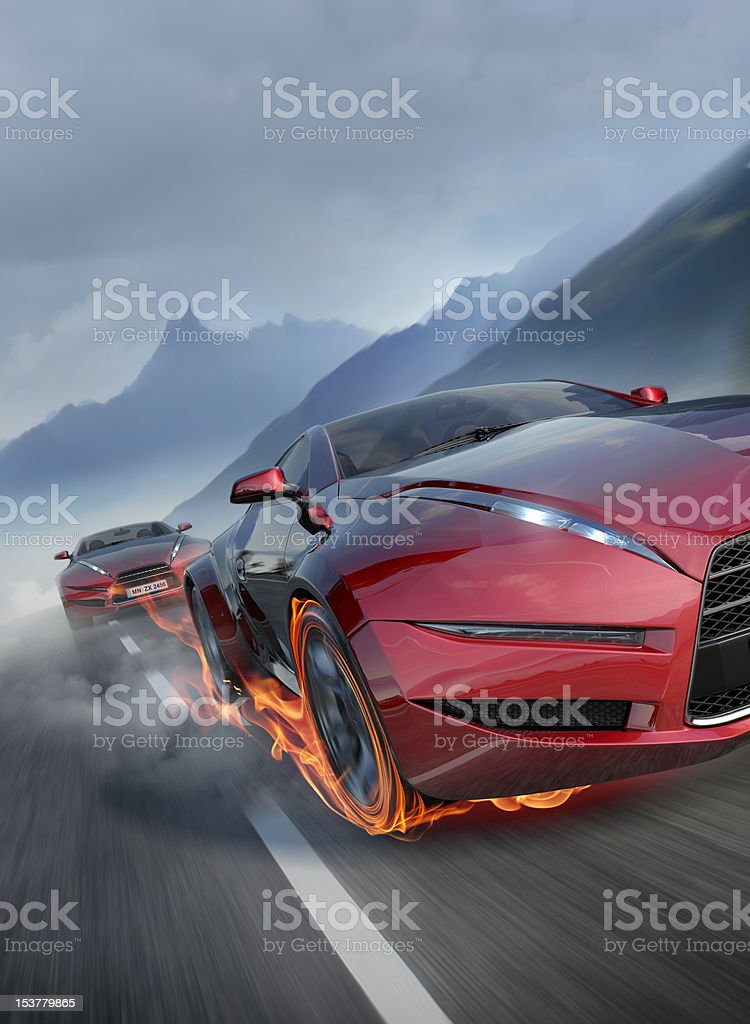 Sports cars moving on the mountain road stock photo