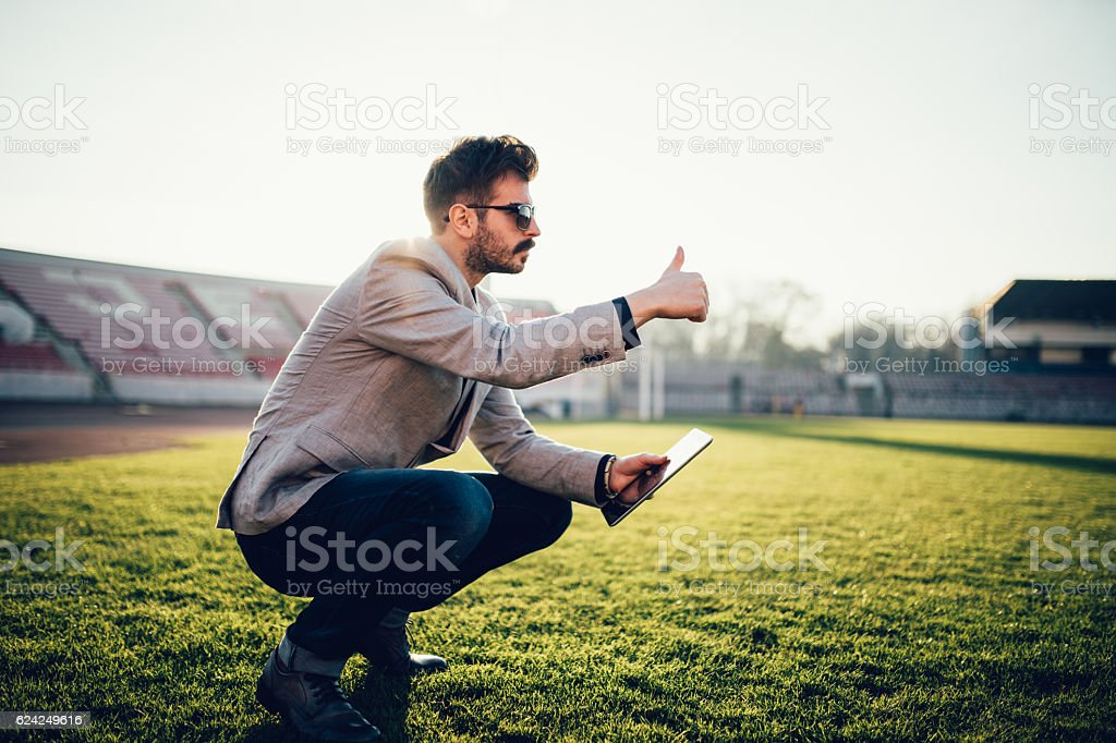 Soccer manager watches the players.Football coach observes...