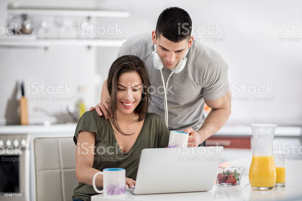 Sports couple in the kitchen stock photo