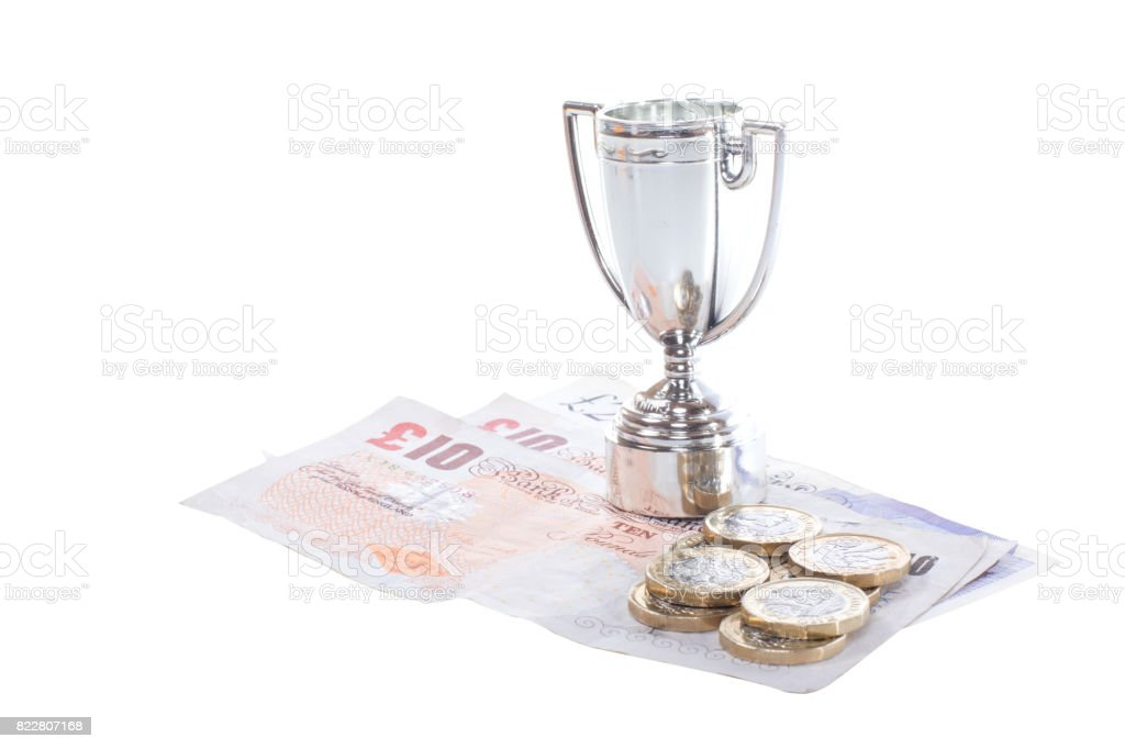 Sports cup and cash money concept stock photo