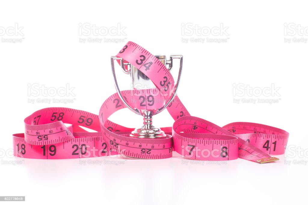 Sports cup with measuring tape stock photo