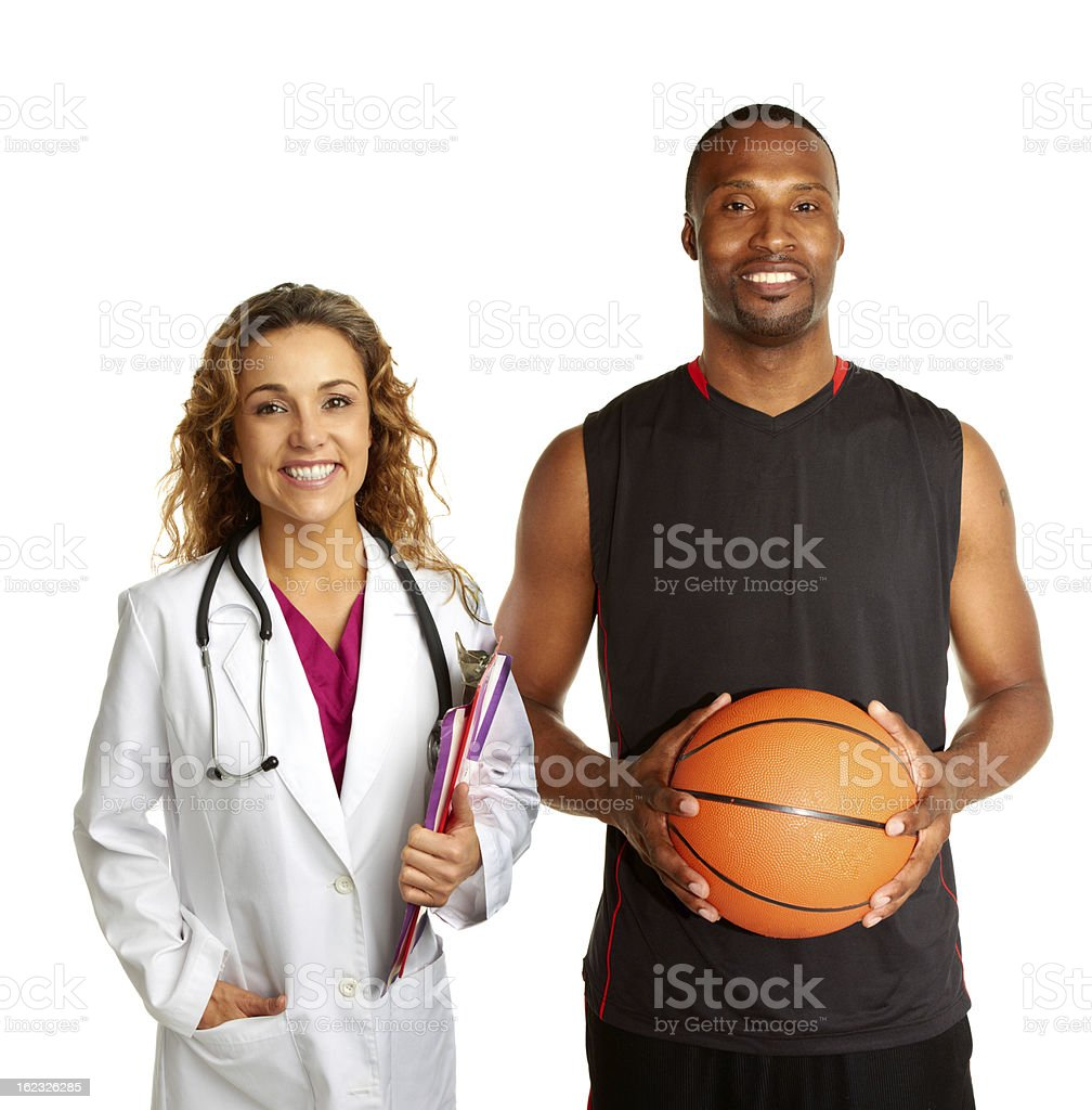 Sports doctor with basketball player royalty-free stock photo