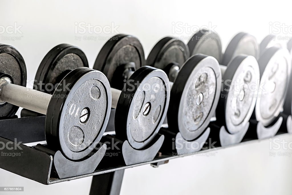 Sports dumbbells in  sports club stock photo