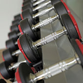 sports dumbbells in the gym