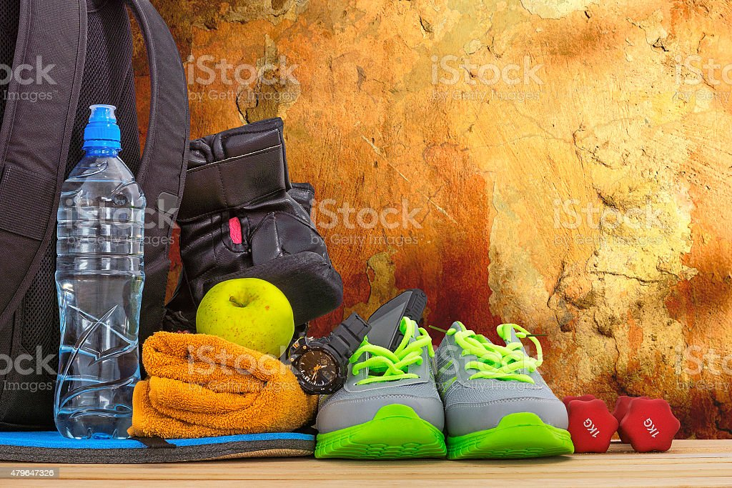 Sports equipment against the wall stock photo
