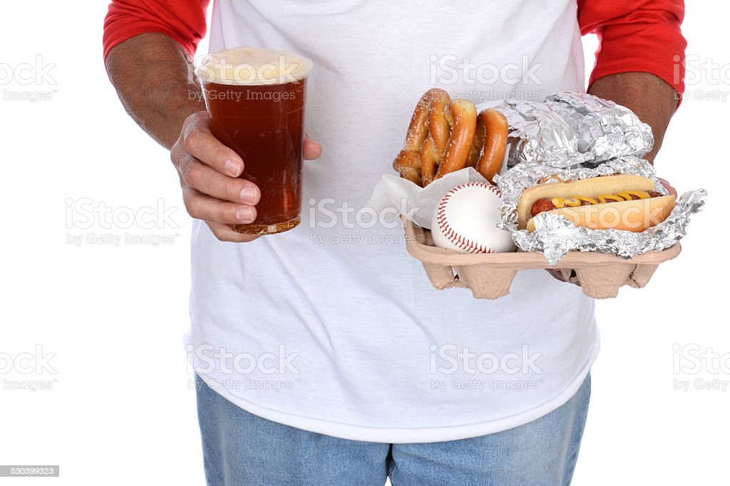 Sports Fan Carrying Food and Beer stock photo