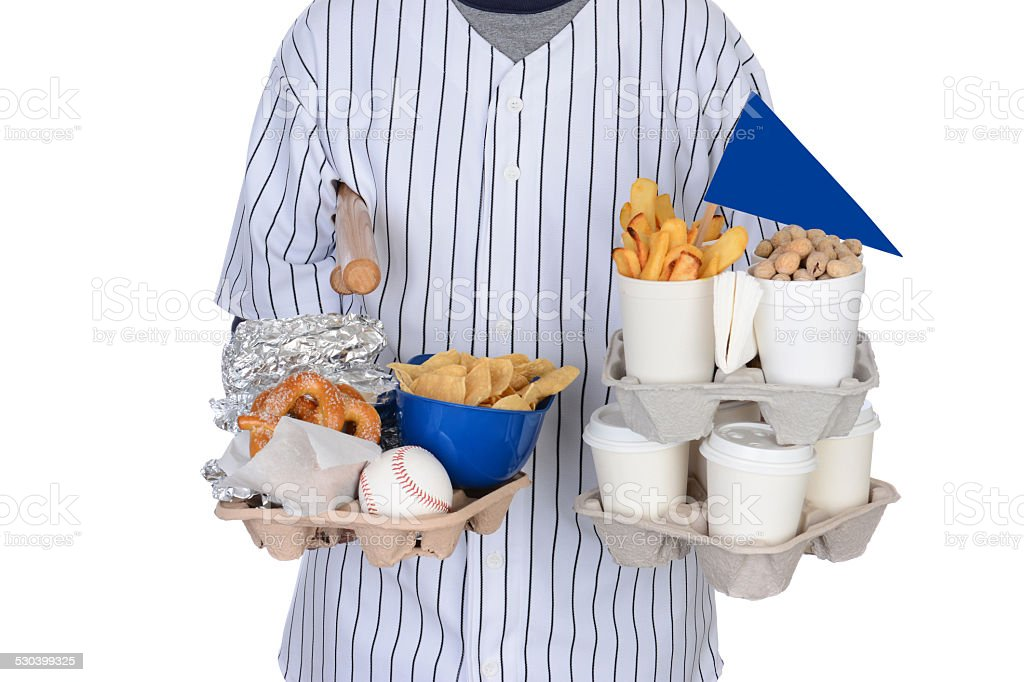 Sports Fan Carrying Food Drinks and Souvenirs stock photo