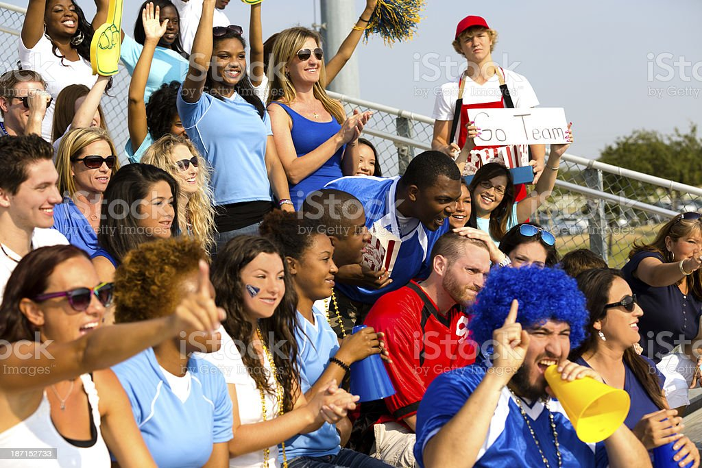 Sports: Fans cheer for their team during local sporting event. stock photo