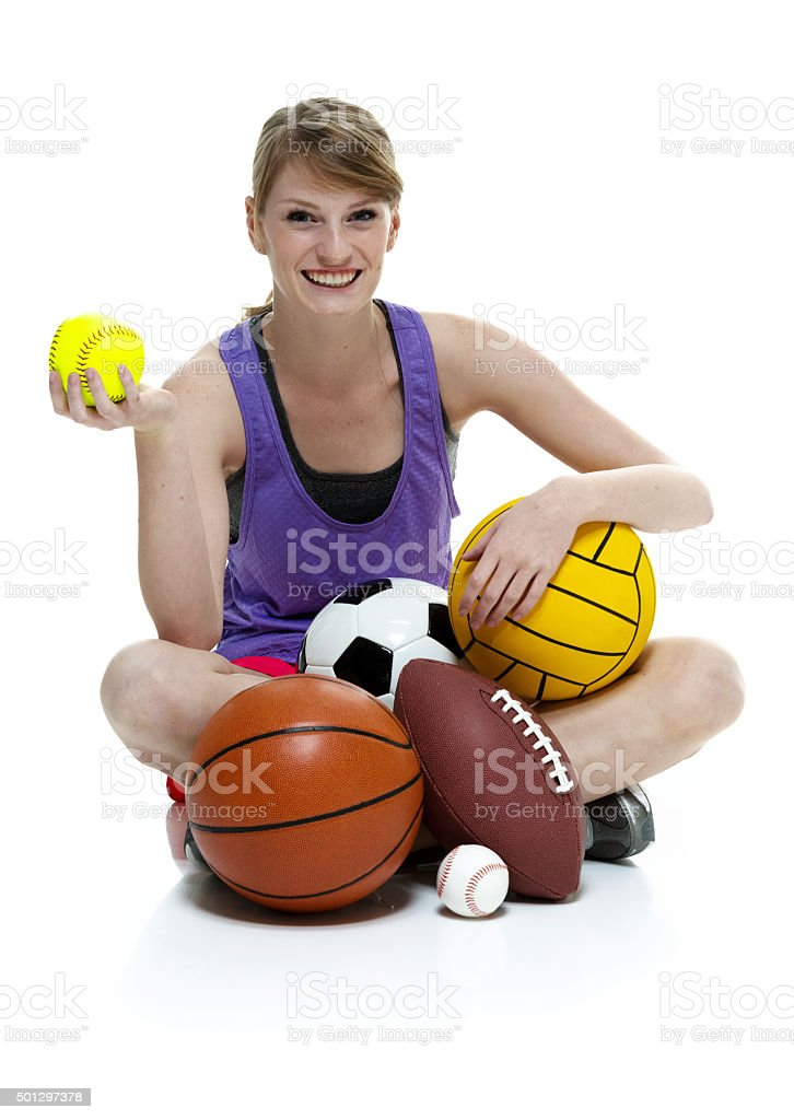 Sports female sitting with balls stock photo