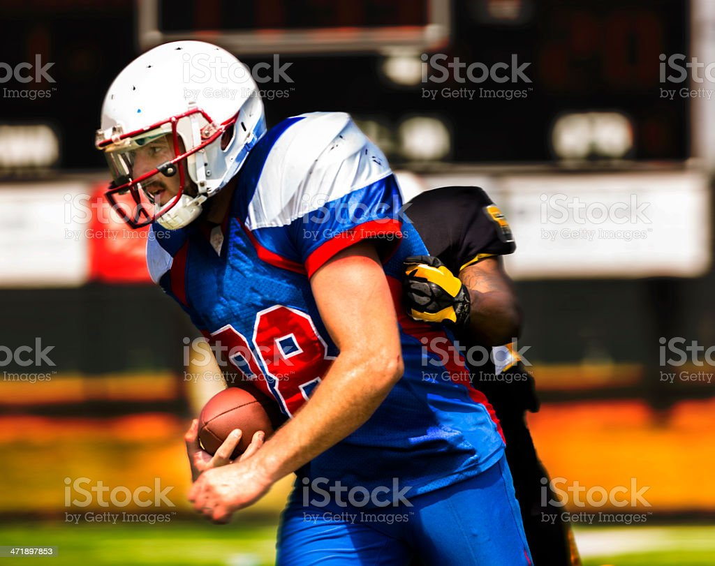 Sports:  Football running back carries the ball. royalty-free stock photo