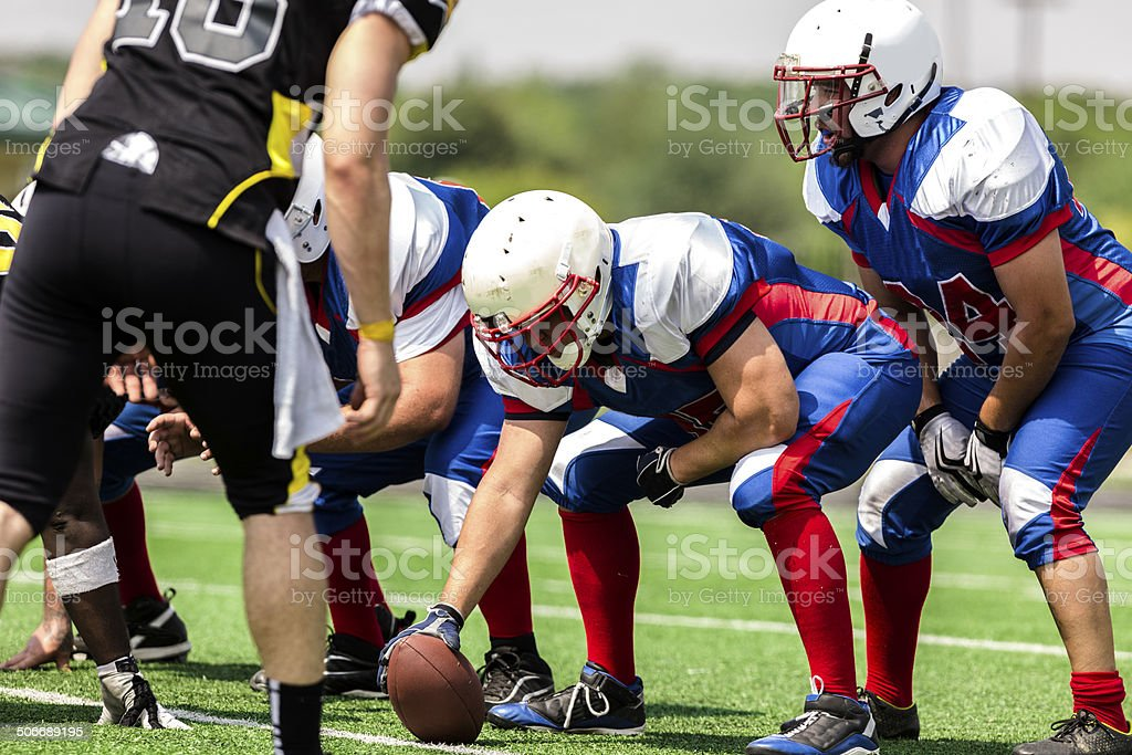 Sports: Football teams prepare for a play.  Line of scrimmage. stock photo
