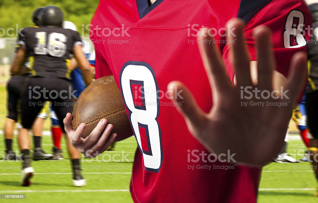 Sports:  Football team's running back carries the ball. royalty-free stock photo