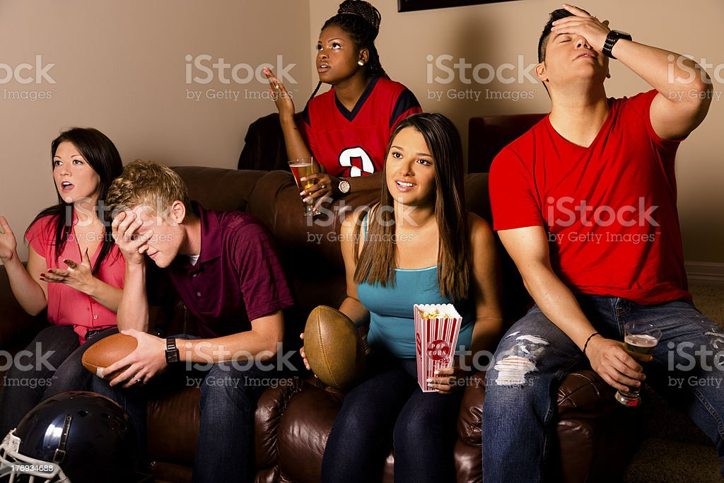 Sports: Friends upset after their team misses a field goal. stock photo