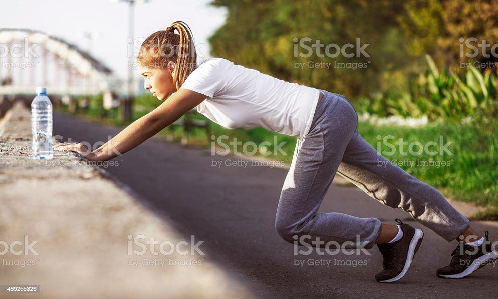 Sports girl doing push ups stock photo