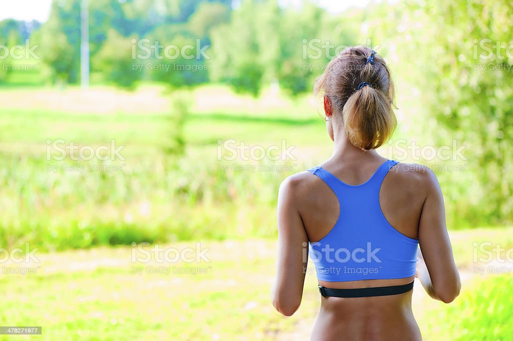 sports girl runs  in the park royalty-free stock photo