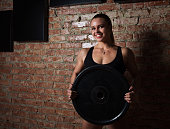sports girl with dumbbells wall
