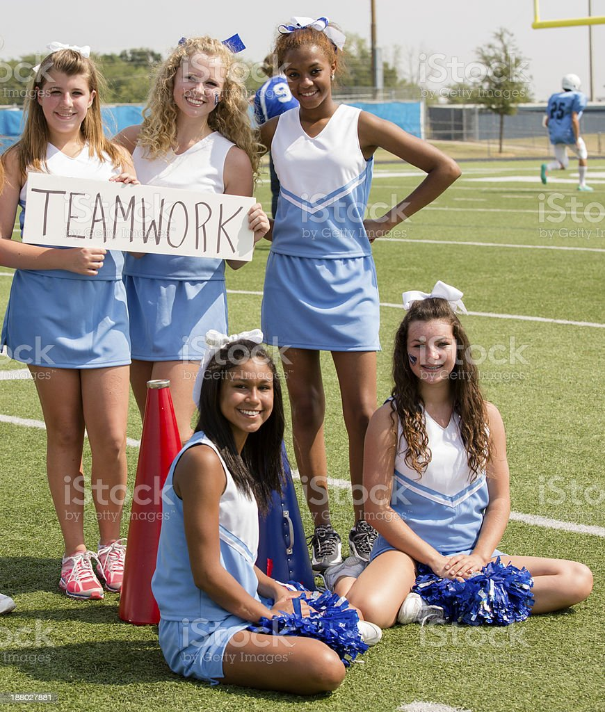 Sports:  Group of cheerleaders with 'teamwork' sign. stock photo