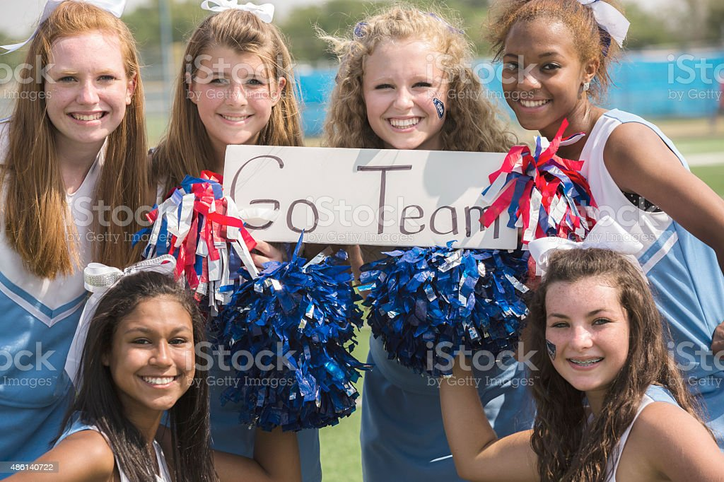Sports: Group of high school cheerleaders with 'Go Team' sign. stock photo