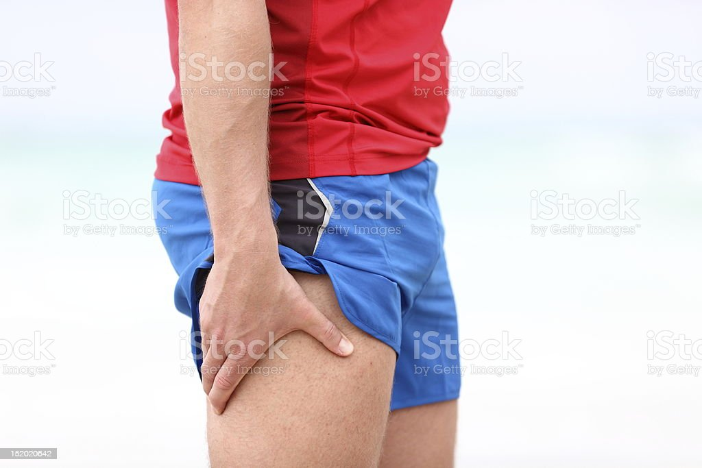 Sports injury - thigh muscle pain stock photo