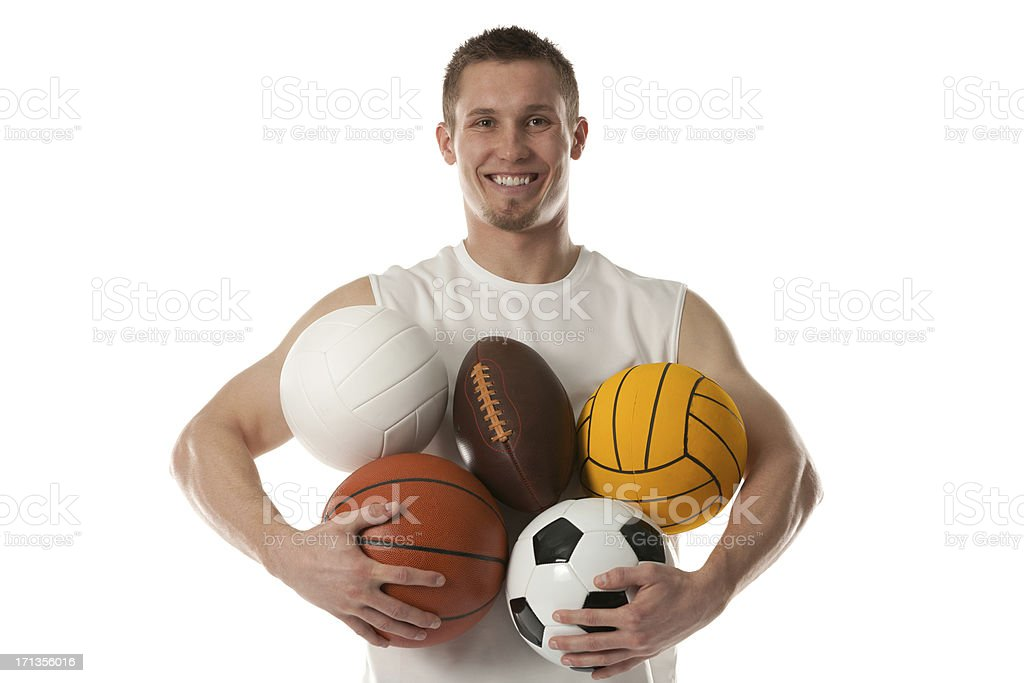 Sports man holding assorted balls royalty-free stock photo