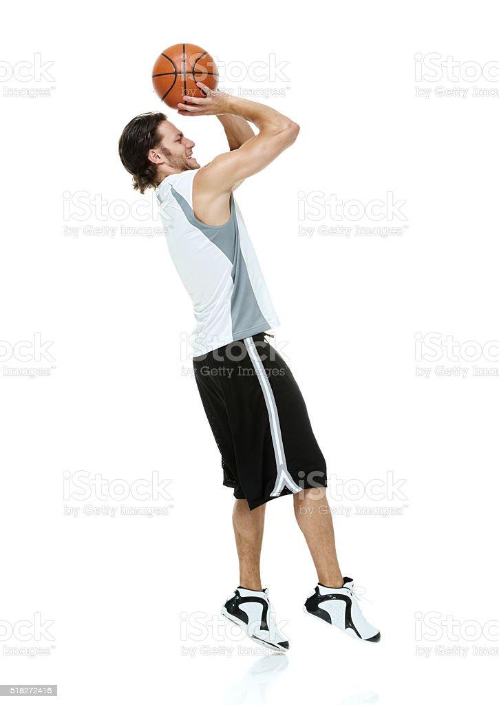 Sports man playing basketball stock photo