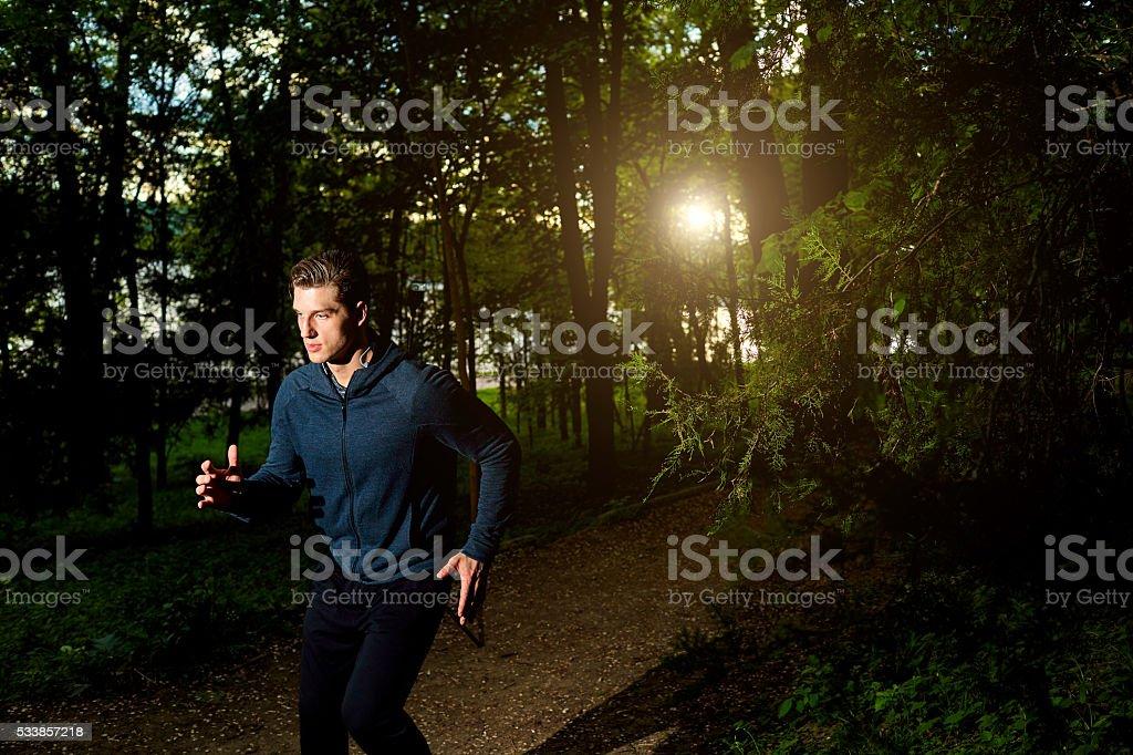 Sports man running at night. stock photo