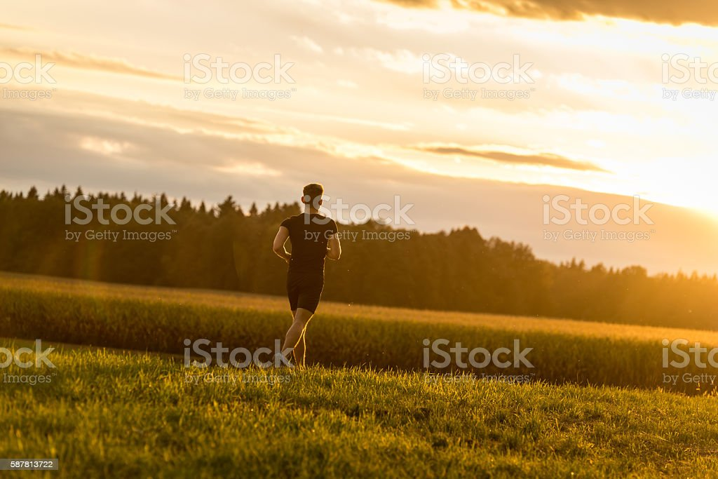 Sports man running outdoors stock photo