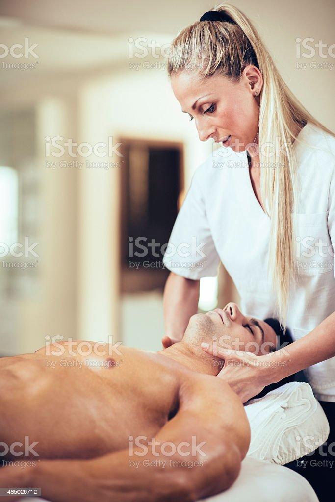 Sports massage - Massaging Neck stock photo