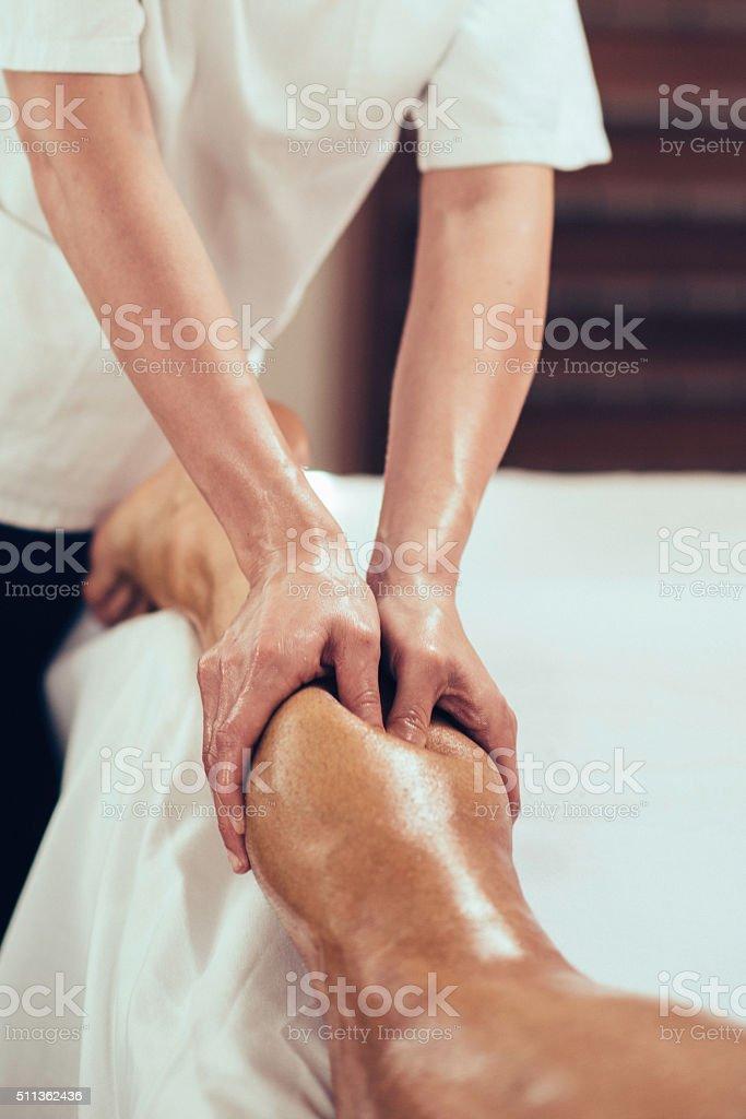 Sports massage of legs stock photo
