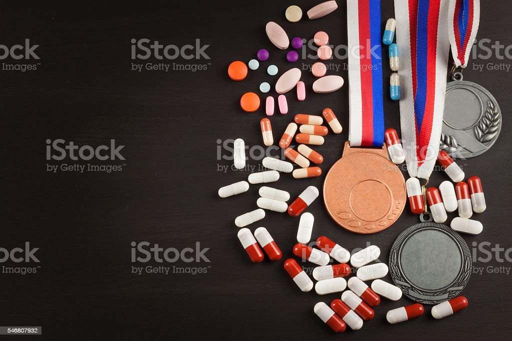 Sports medals on a wooden background. stock photo