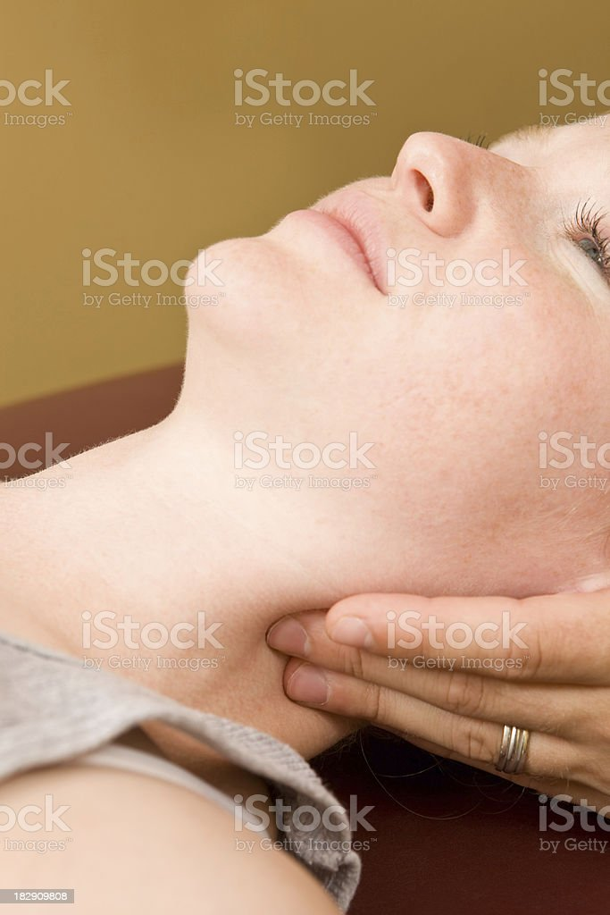 Sports Medicine Doctor Working a Woman's Neck royalty-free stock photo