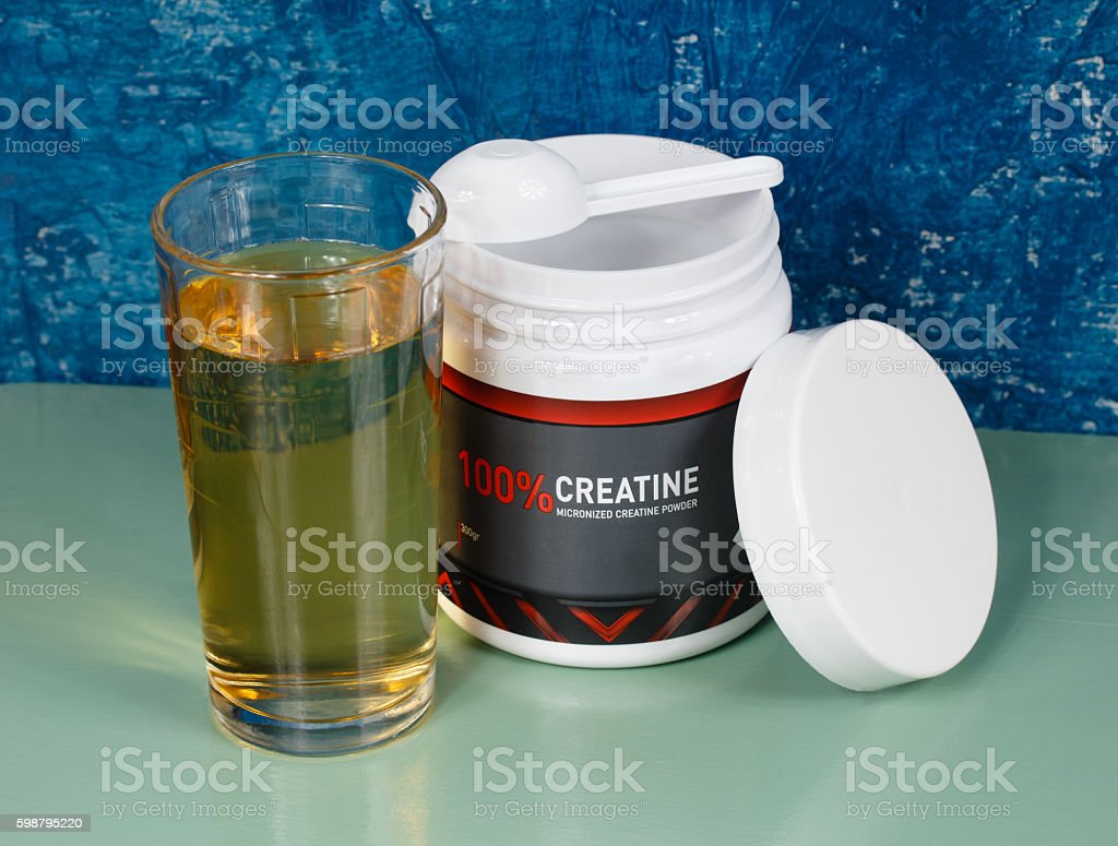Sports nutrition. Creatine and grape juice stock photo
