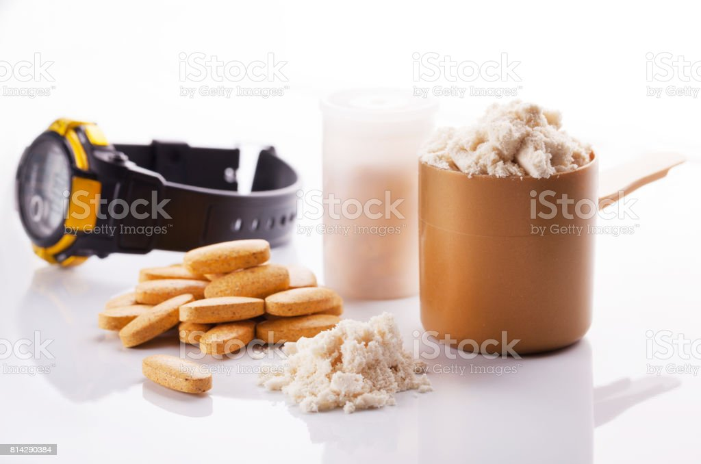 Sports nutrition, proteins and vitamins on a wooden background. stock photo