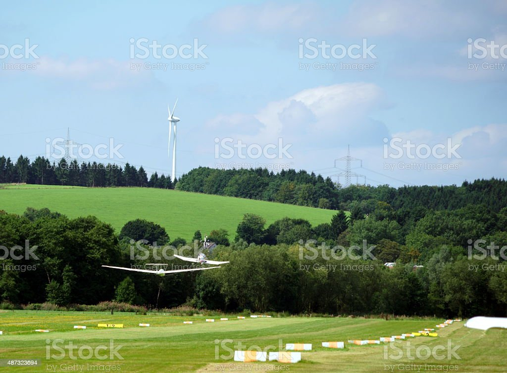 sports plane pulling a glider stock photo