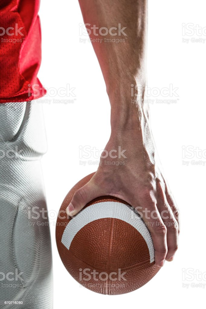 Sports player holding ball royalty-free stock photo