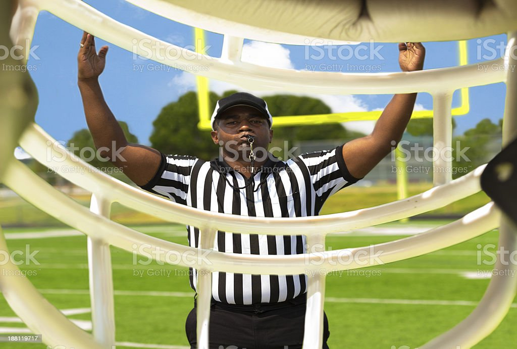 Sports:  Referee calls a touchdown on football field. stock photo