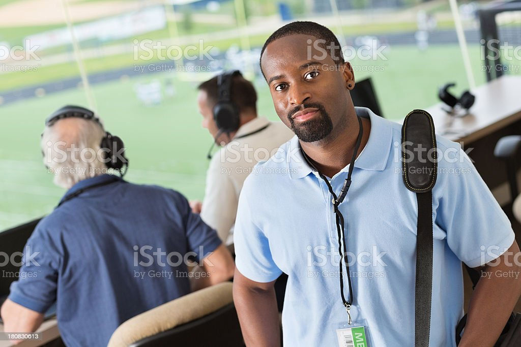 Sports reporter arriving at stadium press box to cover game stock photo