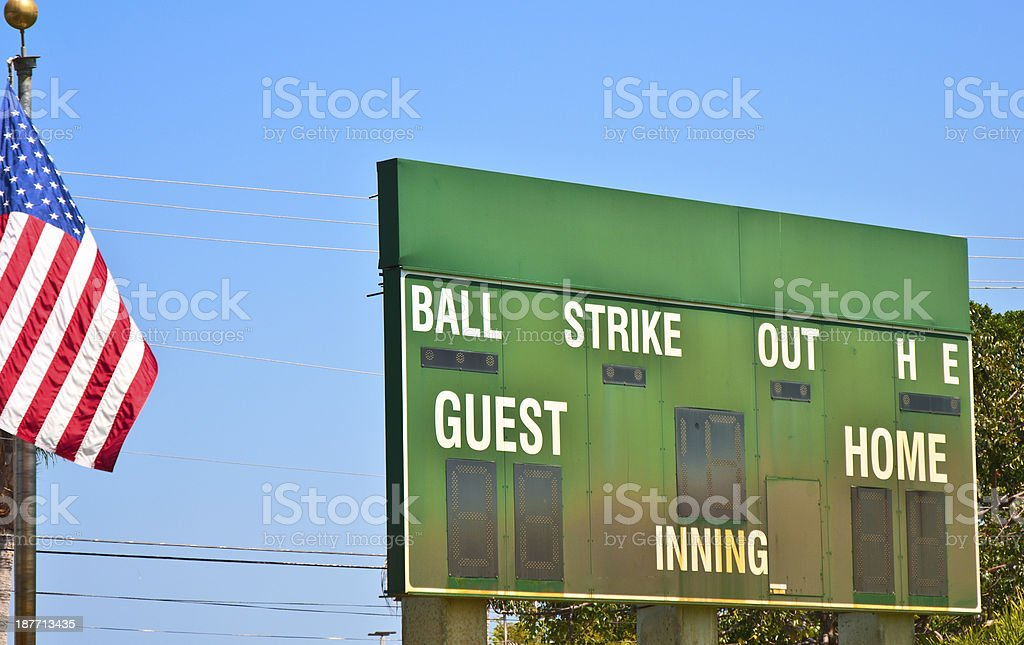 Sports Scoreboard And American Flag Outdoors In Summer royalty-free stock photo