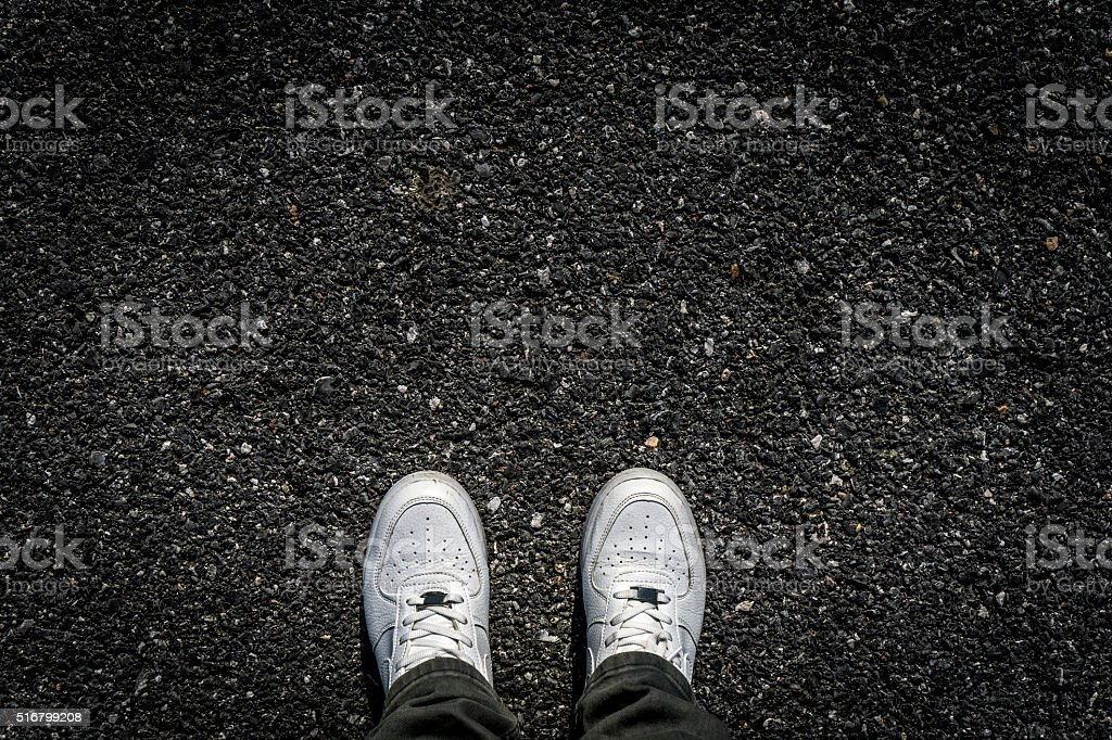 Sports Shoes on Asphalt stock photo