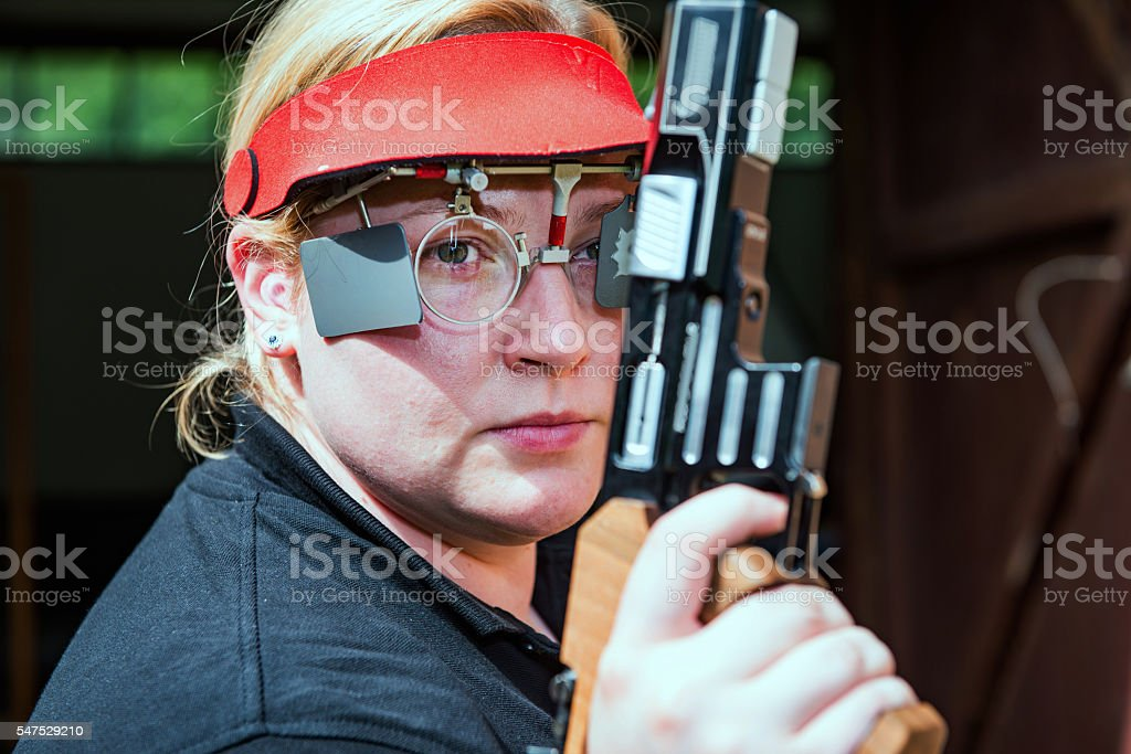 Sports shooting competitor stock photo