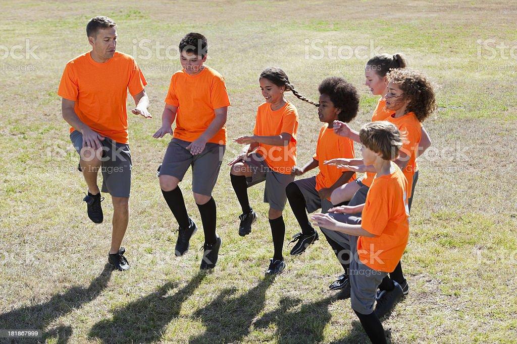 Sports team exercises royalty-free stock photo